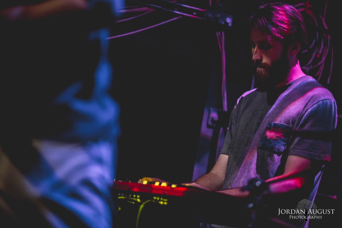 Photo of Keyboardist Ty Playing on Stage